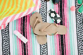 beijos picks beach bag essentials we have our trusty havaianas flip flops we live in ours all summer long our salt sunglasses and of course our gunn swain beach blanket