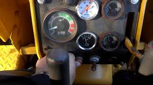 starting and driving a john deere 450c bulldozer