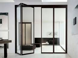 folding black frame glass doors separating the kitchen and the living room