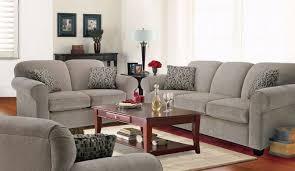 Living Room With White Walls Black Ceramic Tile Floors And White Sofa For Living Room