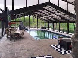 indoor pool and hot tub with a slide.  Indoor Ha  Inside Indoor Pool And Hot Tub With A Slide O