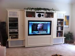 living room large white wooden tv cabinet with frosted glass doors and racks on shabby floor black sitting room set design larger lcd wall mounted unit