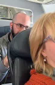 Woman who filmed man punching her plane seat plans to sue American Airlines  for defamation | Daily Mail Online