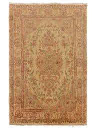 this is a tabriz hand made area rug from china it measures about 4 by