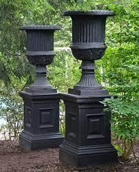 large cast iron urns and pedestals
