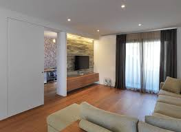 amusing design ideas of living room with l shape colored sofas and tv on wall also beauteous living room wall unit