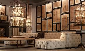 contemporary living room with wall sconce cement fireplace restoration hardware vintage birdcage candelier