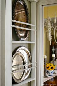 diy plate rack with silver platters atthepicketfence com