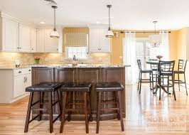 white cabinets with maple island