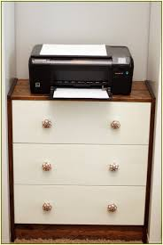 a printer on corner printer desk with drawer