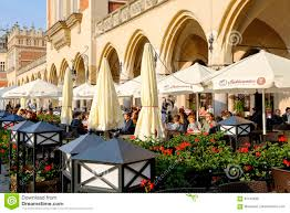 Krakow poland may 25 2017 outdoors restaurant by the cloth hall is located in the old town square there are many people who can be seen