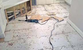 removing tile from concrete floor bathroom tile concrete and lath removal removing tile adhesive from cement floor