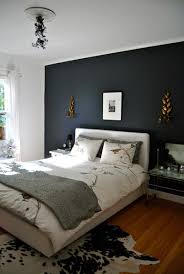 pair dark gray walls with bright gold decorations for a balanced look in your gray bedroom