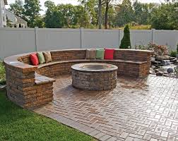 paver patio with fire pit and bench
