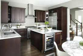 white marble countertops gry honed carrara kitchen with dark cabinets grey