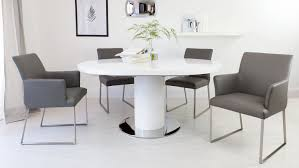 round white gloss extending dining table and real leather dining chairs you