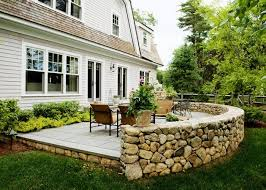 stone patio wall luxury backyard patio patio yard boss landscape design llc mattapoisett ma