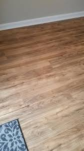 trafficmaster lakes pecan 7 mm thick x 7 2 3 in wide x 50 5 8 in length laminate flooring 24 17 sq ft case 35947 the
