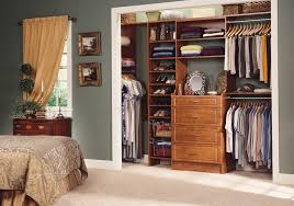 three hanging rods opened shelf four drawers brown wooden reach in california closets full