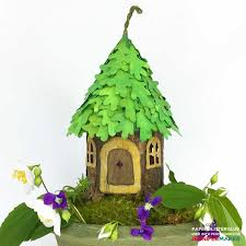 diy fairy house with an oak leaf roof made entirely from paper and glue with a