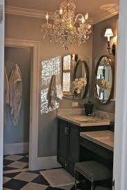 bathroom lighting chandelier. Elegant Bathroom-oval Mirror Framed In Cherry, Silvery Blue On The Walls, Crystal Chandelier, And Rattan Shades Bathroom Lighting Chandelier