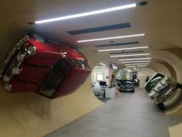 parked outside offices as if they were parked on a drive outside your front door the 3 minis in side the tunnel are replicating a scene from the 1969 auto trader offices london