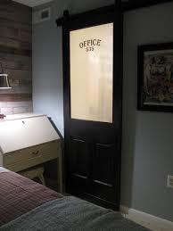 transform a vintage door into a sliding barn door diy