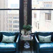 blue leather chair. Urban Living Room Boasts Chic Blue Club Chairs Leather Chair