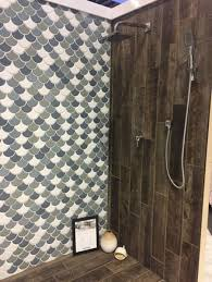 shower display from the builder show with wood plank tile floor and wall