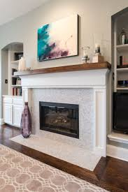white marble fireplace with hexagon pattern