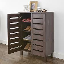 Slatted Shoe Storage Cabinet at STORE. Mahogany effect shoe storage cabinet  with slatted doors. Store up to 12 pairs of shoes