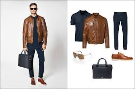 a brown leather jacket and matching brown leather shoes pair with navy cotton pants a navy polo a navy briefcase and gold sunglasses to complete this