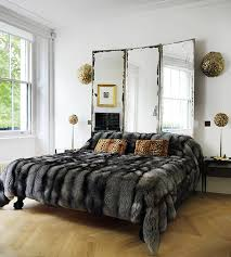 tall headboard with mirror making a small bedroom seem larger