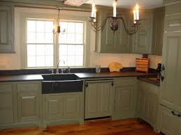 traditional kitchen with black color kitchen honed granite countertops black single bowl undermount sink and oil rubbed bronze chandeliers