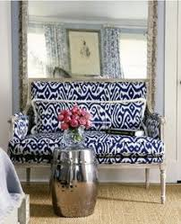 blue white design vignette settee in madeline weinrib blue luce ikat fabric love the huge mirror in front of the settee
