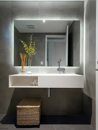 simple led standard mirror with white floating vanity for excellent modern bathroom ideas with concrete floor tiles