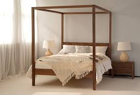 girls four poster beds .