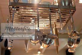Hanging Kitchen Utensils - Stock Photo