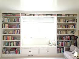 how to build floor to ceiling diy bookshelves with a window seat