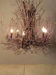 this branch chandelier is a cool way of bringing natural elements into any space it