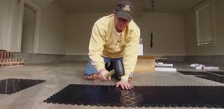 using a rubber mallet to install interlocking tiles on garage floor finishing57 finishing