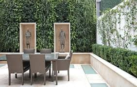 outdoor yard art plastic garden statues and yard art patio transitional with living wall wicker rattan