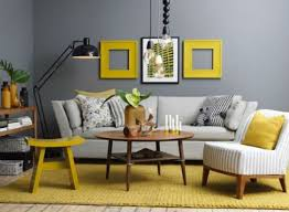 gunmetal grey contrasts with yellow frames, a rug and a stool