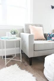 create a master bedroom reading corner with a cozy chair side table white leather