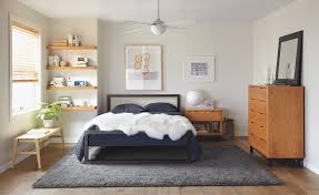 float wall shelves in bedroom with parsons bed