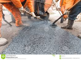 Road Workers Laid Asphalt Repairing The Road Stock Image