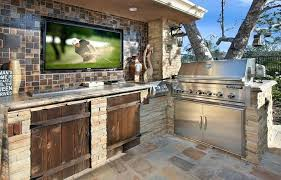 outdoor kitchen designs beige stone poolside plans with fireplace