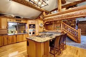 log cabin kitchen with island and large wood beams