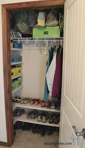 coat closet organization i love the shelves on the side and bottom definitely need to do this and use hooks instead of hangers