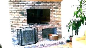 hide wires behind tv how to hide wires over brick fireplace mounting above fireplace hiding wires